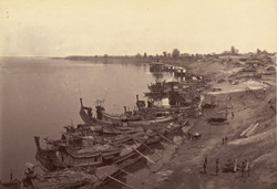 Left bank of the river at Myingyan with native boats moored alongside
